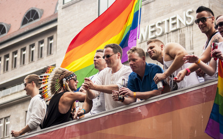 BERLIN, GERMANY - JUNE 21, 2014 Christopher Street Day An unidentified men at the gay pride parade  Crowd of people participate in the parade celebrates gays, lesbians, bisexuals and transgenders in Berlin