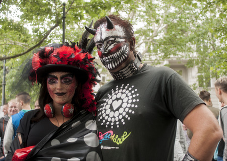 bisexuals: BERLIN, GERMANY - JUNE 21, 2014: Christopher Street Day. Crowd of people Participate in the parade celebrates gays, lesbians, bisexuals and transgenders. Prominent in the image, elaborately dressed participants.