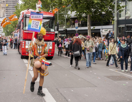 sexy gay: BERLIN, GERMANY - JUNE 21, 2014: Christopher Street Day. Crowd of people Participate in the parade celebrates gays, lesbians, bisexuals and transgenders. Prominent in the image, elaborately dressed participant.