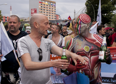 BERLIN, GERMANY - JUNE 21, 2014:Christopher Street Day. Crowd of people Participate in the parade celebrates gays, lesbians, and transgenders. Prominent in the image, elaborately dressed participants.