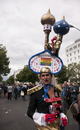 wedding parade: BERLIN, GERMANY - JUNE 21, 2014:Christopher Street Day. Crowd of people Participate in the parade celebrates gays, lesbians, and transgenders. Prominent in the image, elaborately dressed participant.
