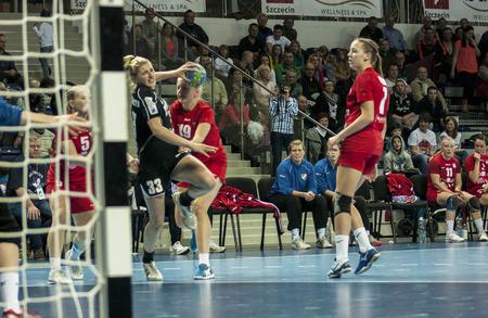 renunciation: SZCZECIN, POLAND - JUNE 21, 2014: Monika Koprowska of Pogon, shoots a goal during Handball Women Editorial