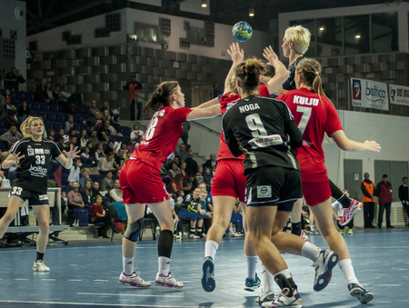 SZCZECIN, POLAND - JUNE 21, 2014: Players in action at a Handball Women Editorial