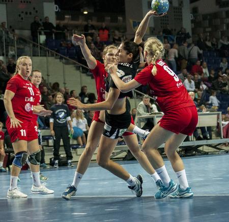 renunciation: SZCZECIN, POLAND - JUNE 21, 2014: Monika Stachowska of Pogon (with ball) in action, during Handball Women Editorial