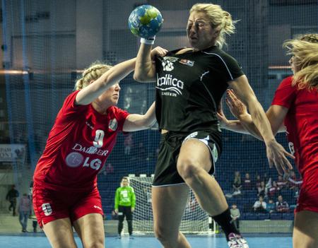 renunciation: SZCZECIN, POLAND - JUNE 21, 2014: Monika Glowinska of Pogon (with ball) in action, during Handball Women Editorial