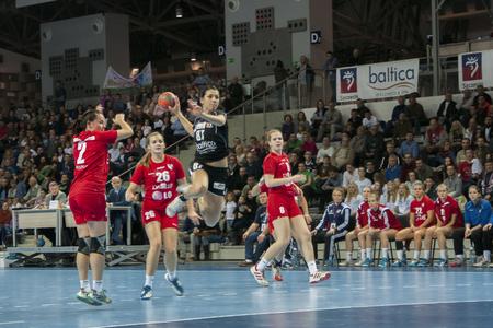 SZCZECIN, POLAND - JUNE 21, 2014: Hanna Yashchuk of Pogon, shoots a goal during Handball Women Editorial