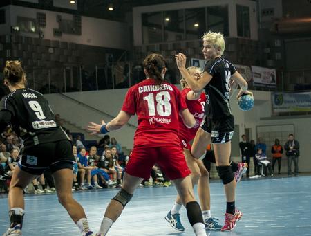 renunciation: SZCZECIN, POLAND - JUNE 21, 2014: Katarzyna Duran of Pogon (with ball) in action, during Handball Women