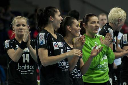 renunciation: SZCZECIN, POLAND - JUNE 21, 2014: Pogon Baltica Szczecin players celebrates the victory over Helsinki at the Handball Women