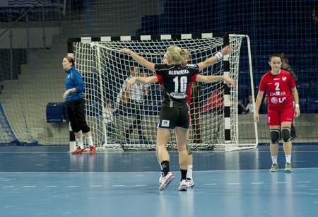 renunciation: SZCZECIN, POLAND - JUNE 21, 2014:Unidentified players in action at a Handball Women Editorial