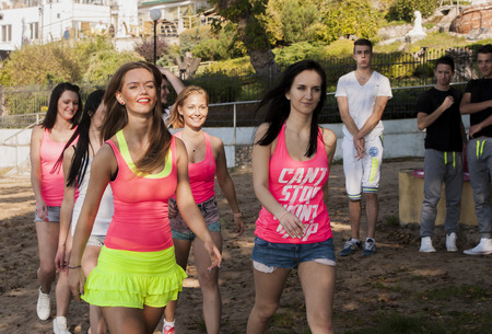 WAGRAWIEC, POLAND - JUNE 21, 2014: Attractive women?s working during shooting music video clip of the polish Disco band Jurad