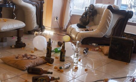 vodka: PNIEWY, POLAND - FEBRUAR 21, 2015: Mess in the house. The trash made after the night party