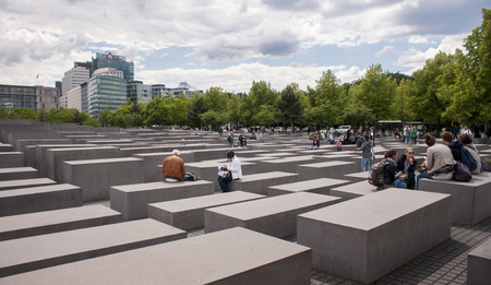 jewess: BERLIN, GERMANY - MAY 30, 2014:Jewish Holocaust Memorial in Berlin. Holocaust Memorial (German: Holocaust-Mahnmal), is a memorial in Berlin to the Jewish victims of the Holocaust.It consists of a 19,000 m2 site covered with 2,711 concrete slabs or stelae