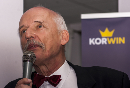 commentator: GOLENIOW, POLAND - MARCH 18, 2015: Janusz Korwin Mikke, candidate for President of the Republic Poland, during meeting with voters. Janusz Korwin Mikke is also Member of the European Parliament, and political commentator. Editorial