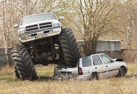 crush: Szczecin, Poland - April 12, 2015: Monster Truck crush this old car during Motoshow in Poland