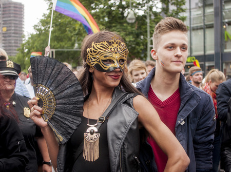 wedding parade: BERLIN, GERMANY - JUNE 21, 2014:Christopher Street Day.Crowd of people Participate in the parade celebrates gays, lesbians, and trans-genders. Prominent in the image, elaborately dressed participants. Editorial