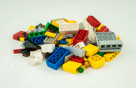yellow lego block: Plastic toy blocks on white background