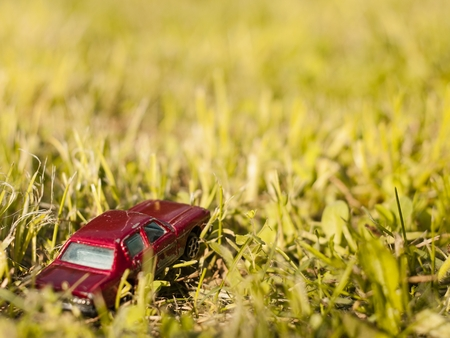 challange: Car in the grass Stock Photo