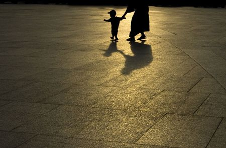 instinct: mother and son silhouette in sunset