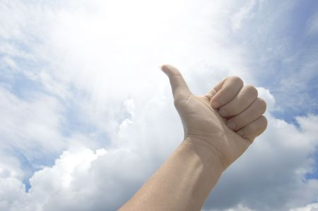 great deal: thumb up hand against blue sky