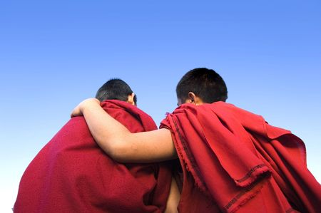 rear view of a monk holding another monk shoulder Stock Photo - 2835385