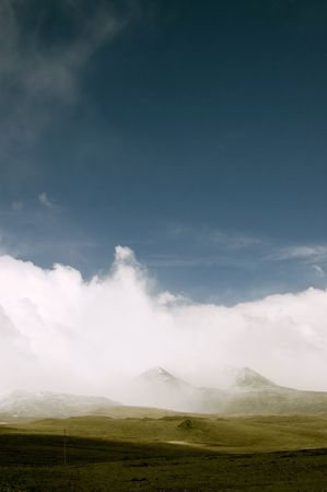 Landscape with mountains and storm clouds photo