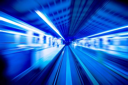 trains passing train station. Focus on the rail road Stock Photo - 2840471