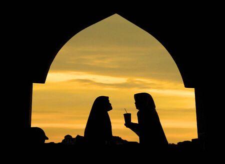 islamic wonderful: islamic woman infront a mosque