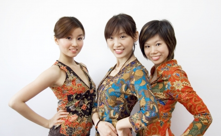 batik: portraits of three asian girls Stock Photo