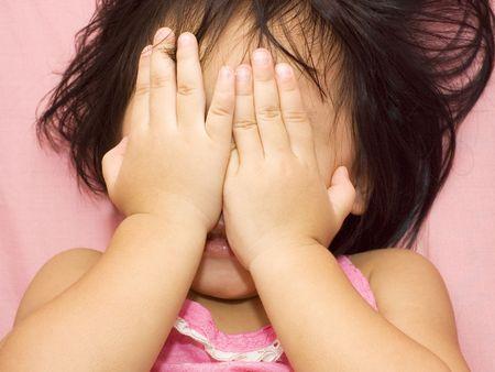 peekaboo: little girl playing peek-a-boo.
