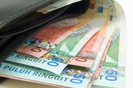 change purses: malaysian currency inside wallet Stock Photo