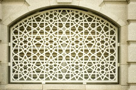 the motive: An example of Islamic design cast in concrete on a building in Putrajaya, Malaysia.