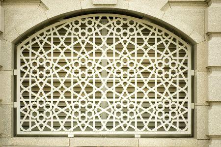 islamic pray: An example of Islamic design cast in concrete on a building in Putrajaya, Malaysia.