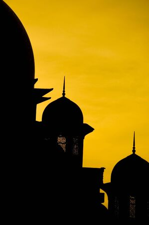 prayer tower: mosque silhouette during sunset