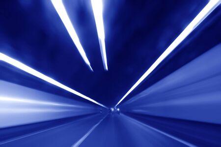 Very high speed drive through a tunnel photo