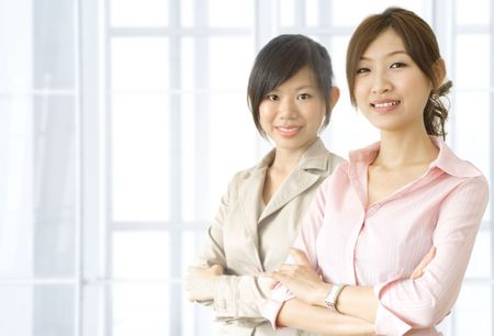 staff team: Asian business women in office environment
