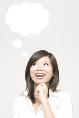 Young girl having a thought bubble 免版税图像