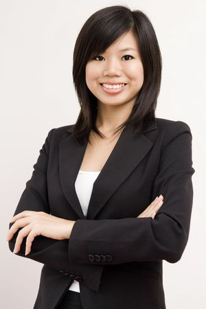 business attire teacher: Confident Asian BusinessEducational women with smiling face Stock Photo