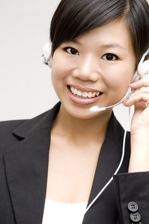 Friendly Customer Representative with headset smiling during a telephone conversation Stock Photo - 3967408