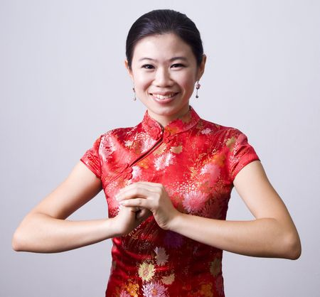 Oriental girl wishing you a happy chinese new year Stock Photo - 4148996