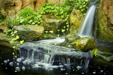 Japanese garden waterfalls, slow shutter. photo