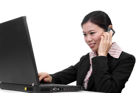Asian businesswoman on the phone and working on her laptop Stock Photo - 4404495
