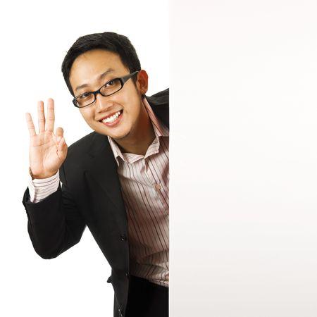 Blank paper for advertisment - Executive male showing OK hand sign photo