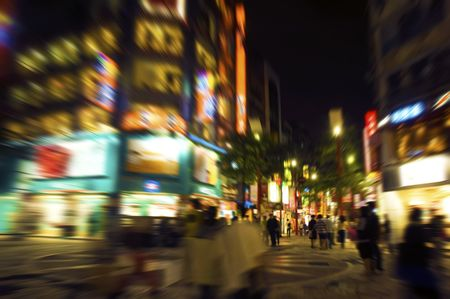 purposely: Busy street at night, Taipei, Taiwan. Purposely blurred with a lens. Stock Photo