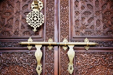 Islamic carved door with beautiful details background.