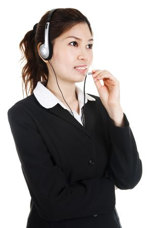 Friendly Customer Representative with headset smiling during a telephone conversation Stock Photo - 4692266
