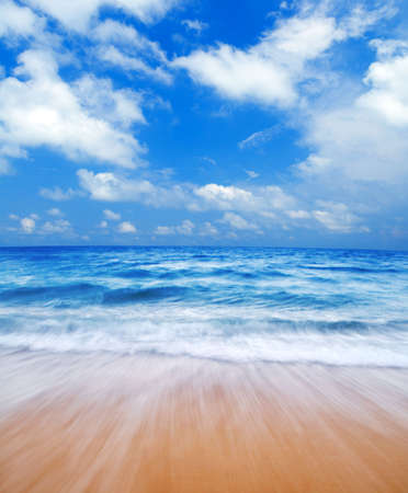 exoticism: Summertime at beautiful blue beach with waves.  Stock Photo