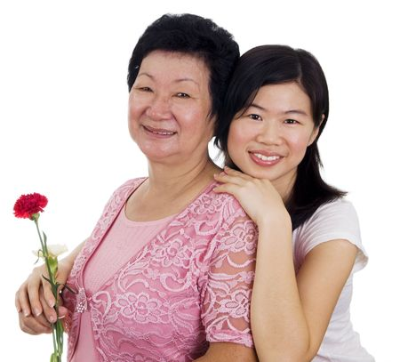 Happy Asian Mother and Daughter with carnation flower Stock Photo - 4790604