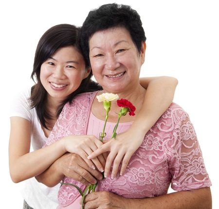 Happy Asian Mother and Daughter with carnation flower