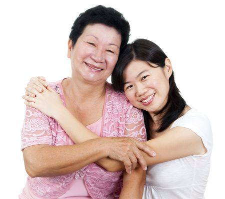 happy asian family: Happy Asian family. Daughter hugging her mother.