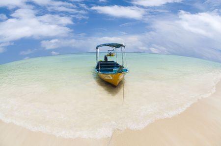 Taxi boat on a tropical beach, Pulau Perhentian, Malaysia. Stock Photo - 4915751